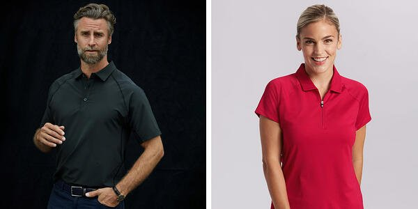 Man wearing Cutter and Buck black forge color and woman wearing Cutter and Buck red forge polo