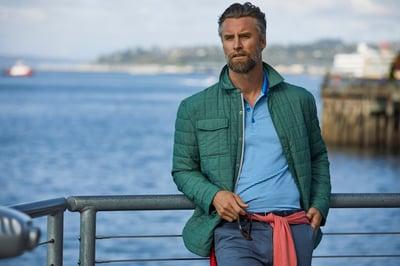 Man wearing Cutter & Buck Rainier PrimaLoft Puffer Jacket by a Lake