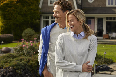 Man and Woman wearing Cutter & Buck at a lake house