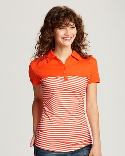 Woman wearing a colorful orange Cutter & Buck CBUK Ladies Spree Polo