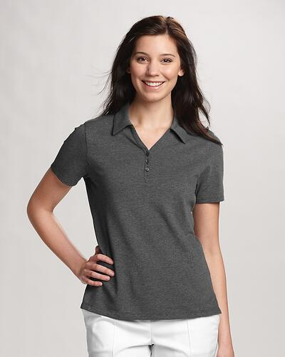 Woman wearing grey Cutter & Buck Ladies Championship Polo with her hand on her hip