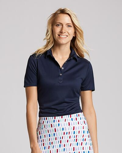 Woman wearing Cutter & Buck Ladies Fiona Polo with patterned skort
