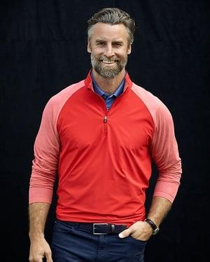 man wearing Cutter and Buck Men's Response Hybrid Half-Zip in Red