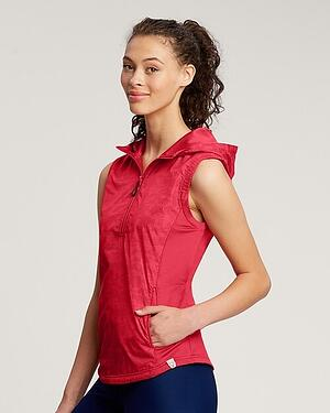 woman wearing Cutter and Buck Women's Swish Printed Sport Vest in Red