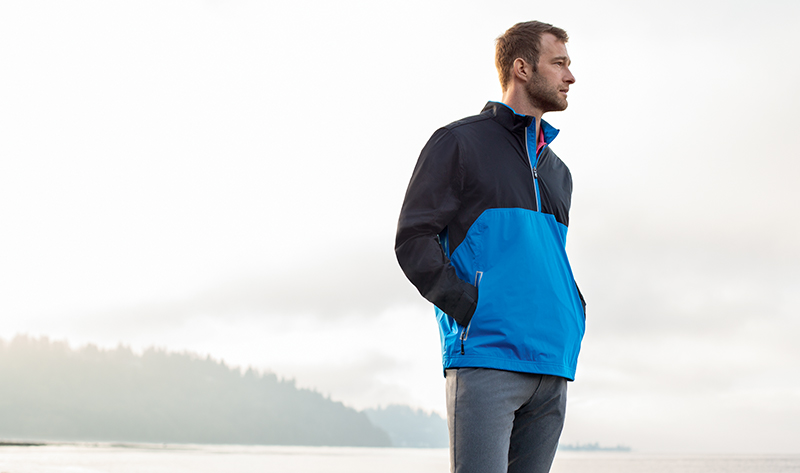 Man wearing a Cutter and Buck Fairway Half-Zip rain jacket