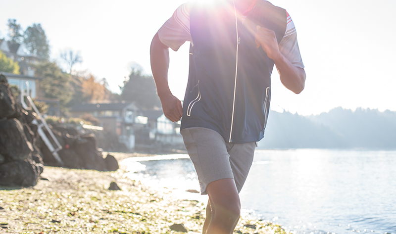 Man running in Cutter and Buck Bainbridge flat front shorts