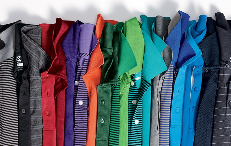 A collection of Cutter and Buck men's polos