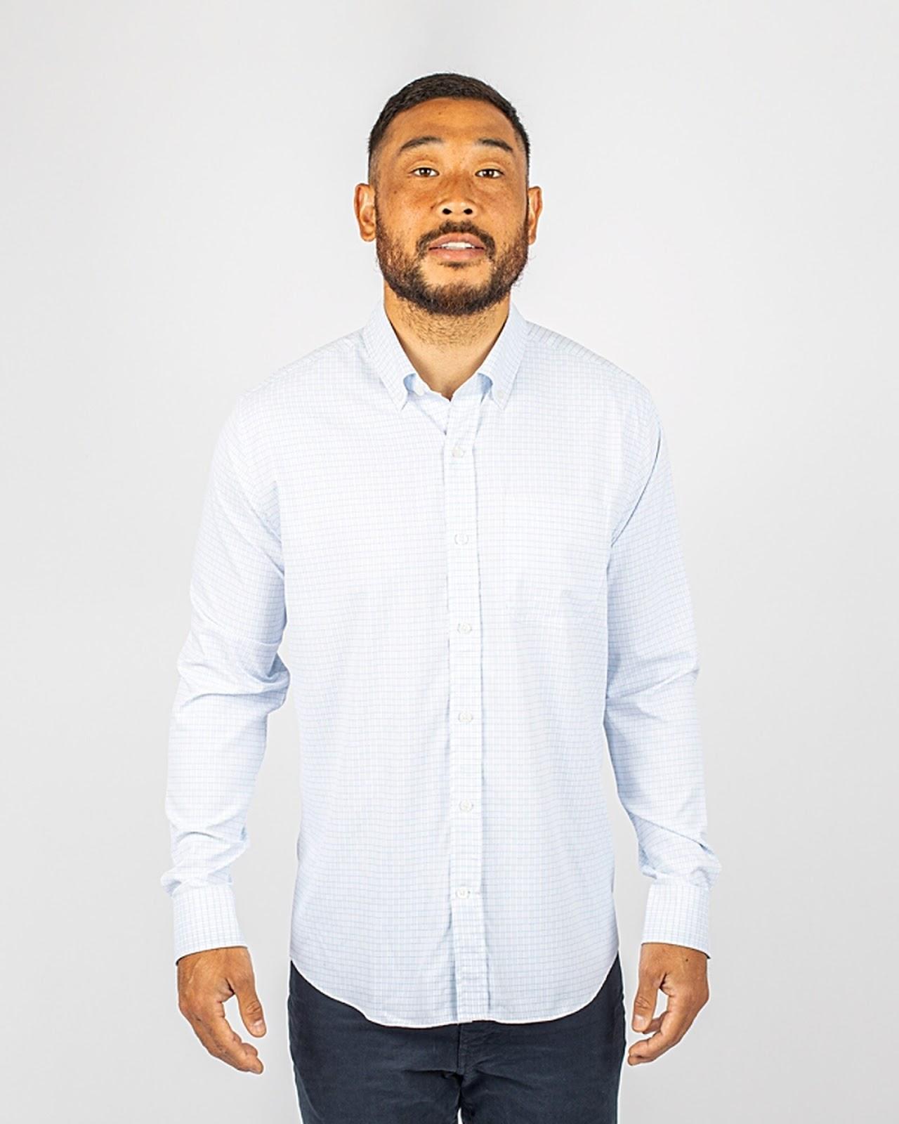 Man wearing Cutter and Buck Men's Versatech Tattersall Shirt